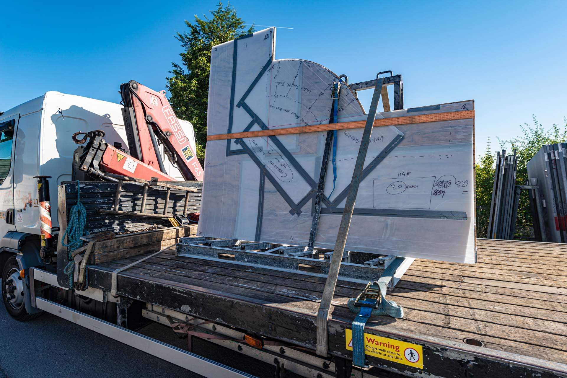 loaded and ready to go granite kitchen island on flatbed truck
