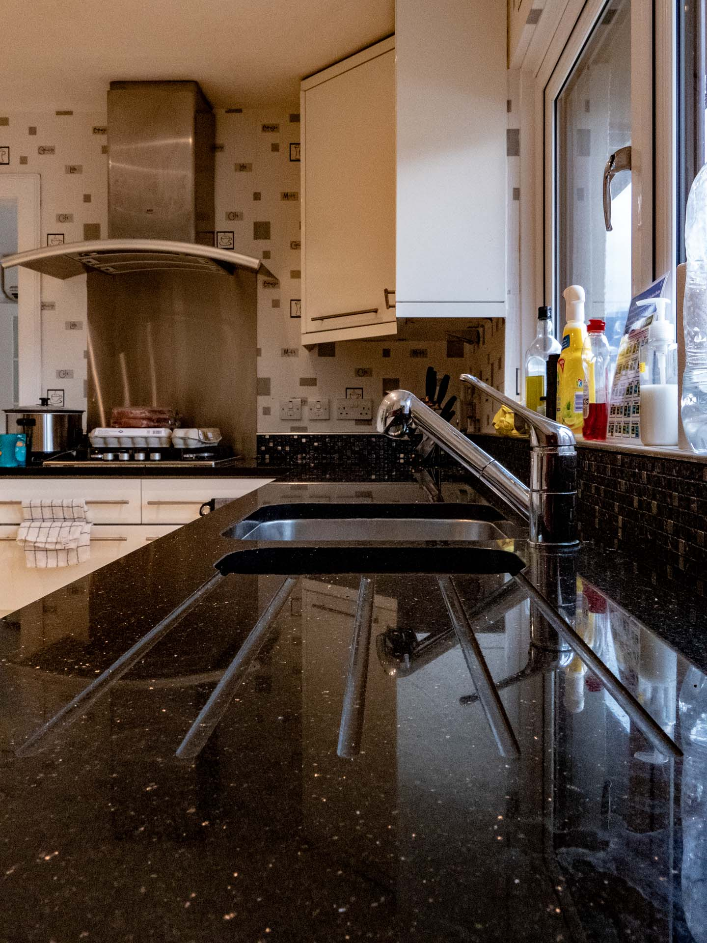 Black Galaxy Granite worktops charlwood reigate surrey sloping drainer grooves 121259a