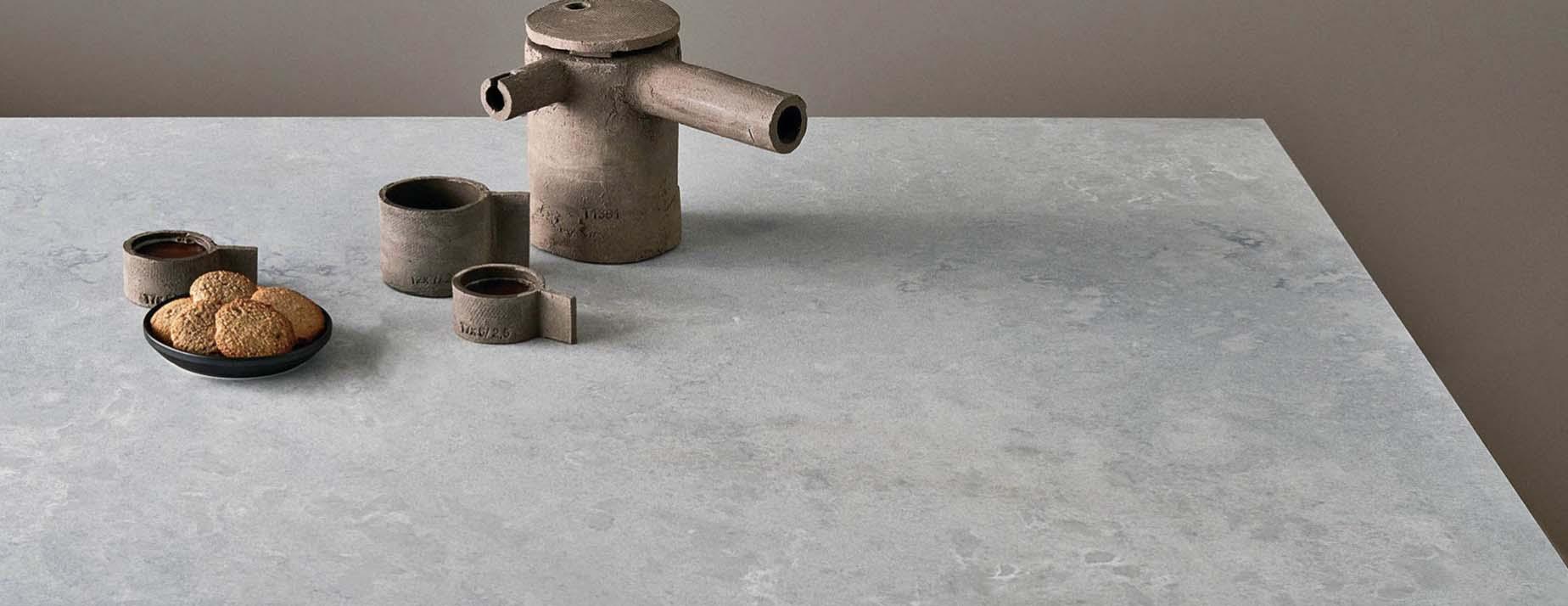 airy concrete Caesarstone quartz worktops granite surrey
