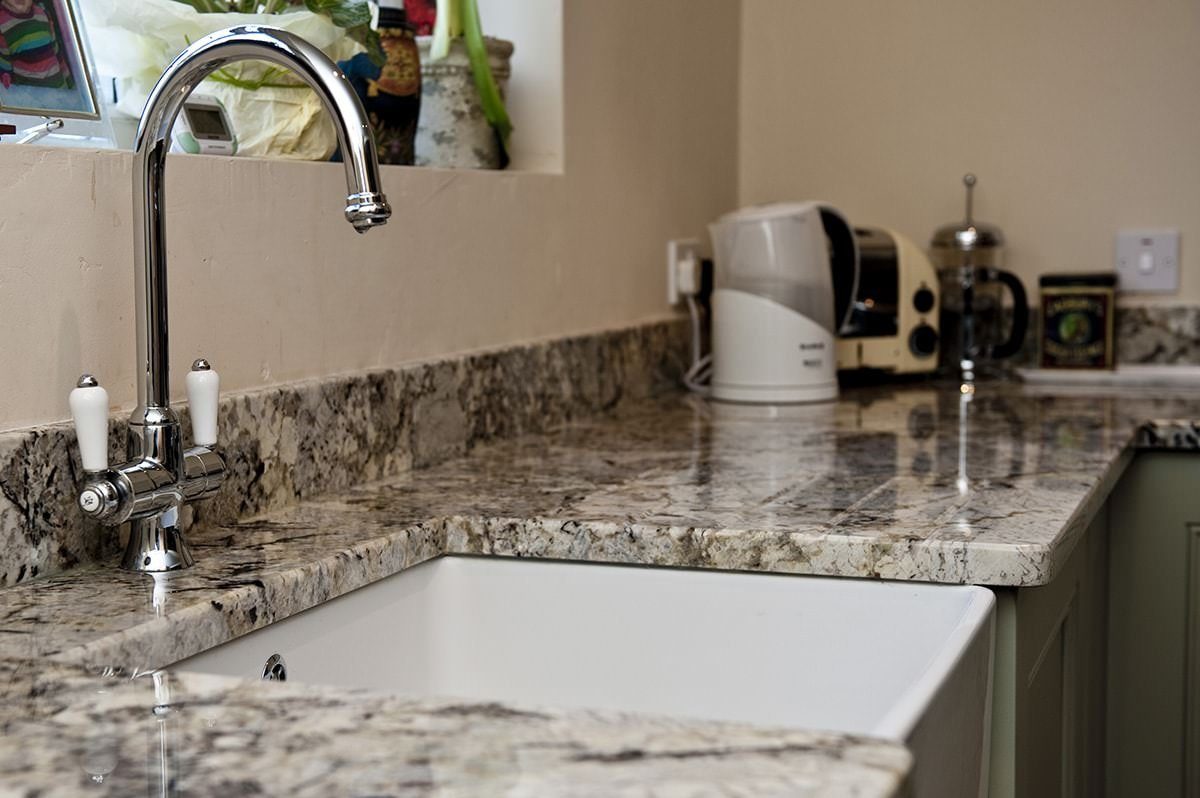 arctic-cream-granite-oxted-123527-a-sink-and-tap-min