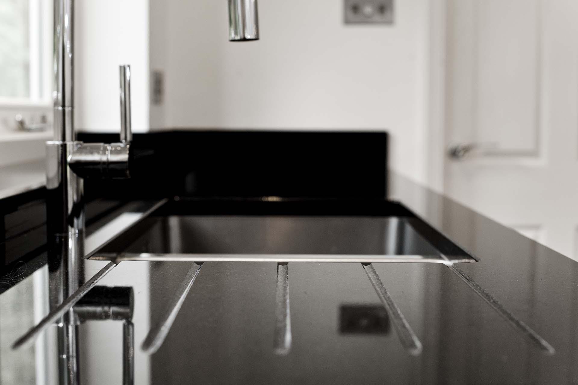granite and quartz nero assoluto granite worktops cimstone lapland quartz_white_sparkly_black_140331103232a red