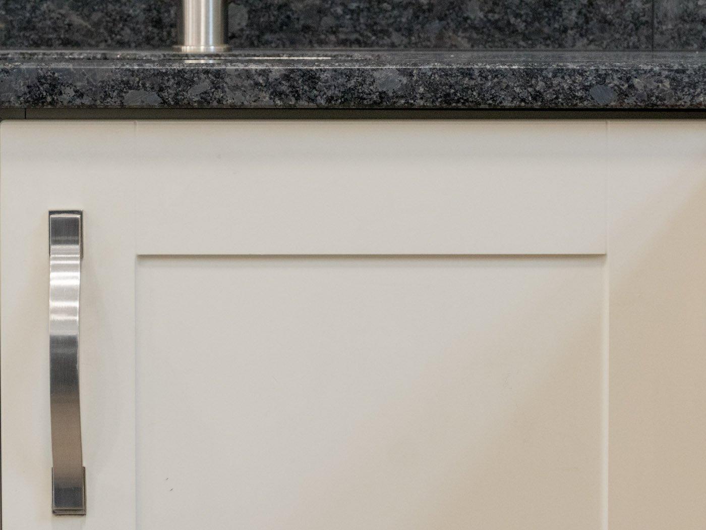 steel-grey-bevel-edge-profile-on-grey-shaker-kitchen