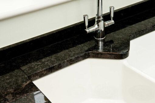 steel-grey-granite-cuckfield-sussex-kitchens-112828a-sink-cutout-detail_1