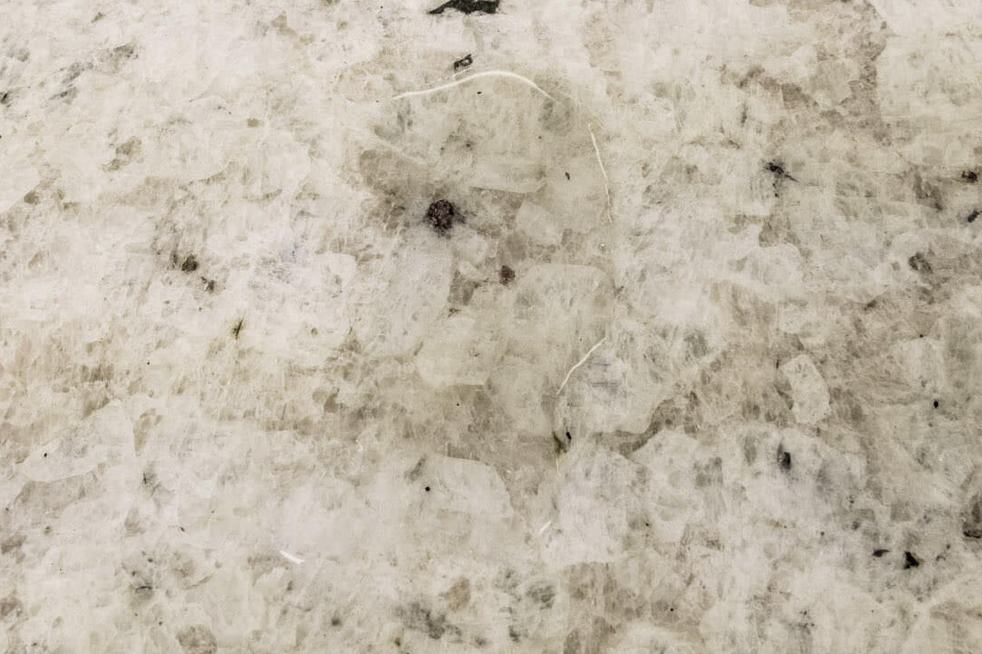 water on colonial white granite worktop sealing