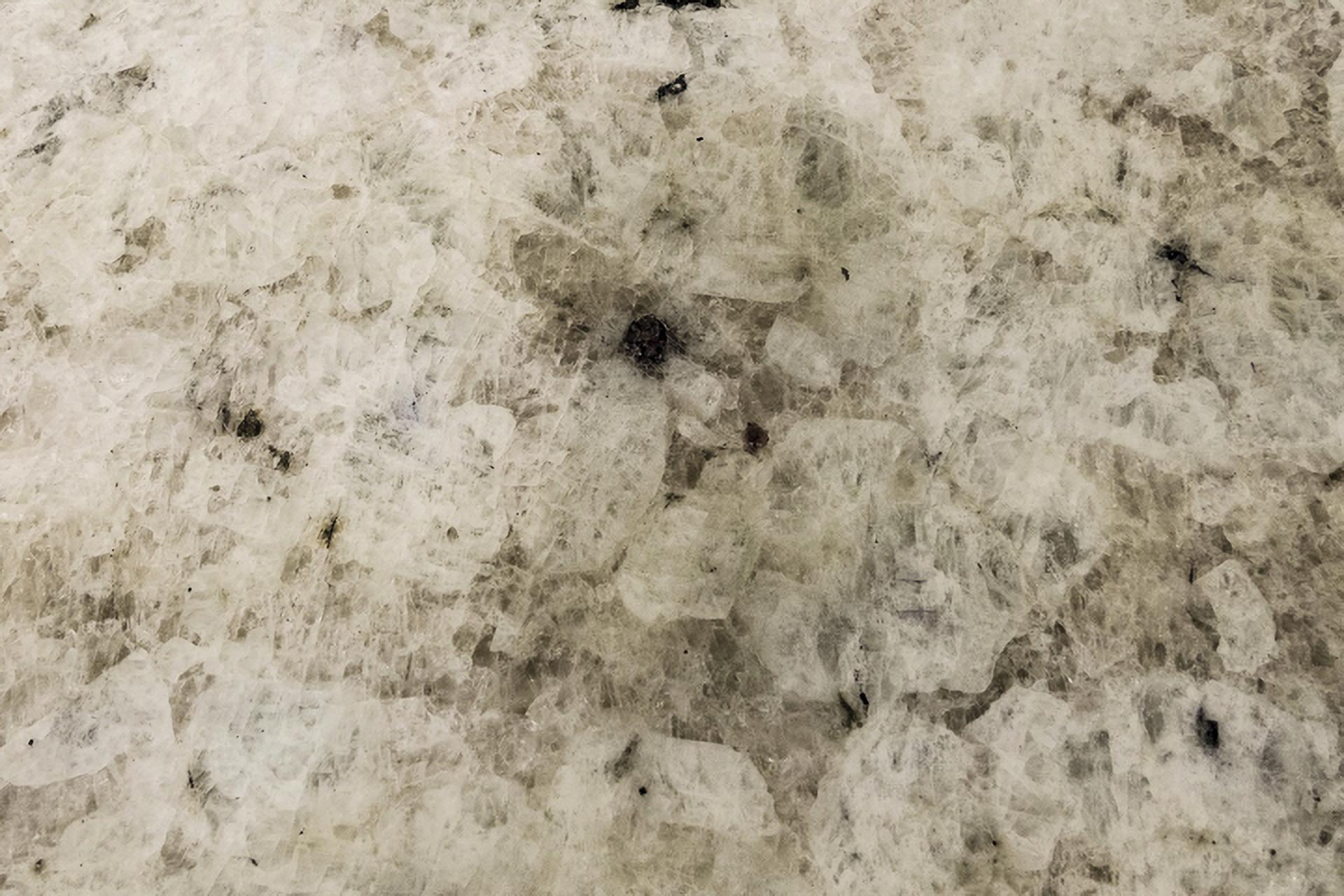 water wiped off and stain left on colonial white granite worktop